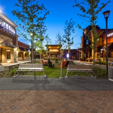 Mellow Mushroom, PF Chang's and BJ's Brewhouse storefronts at dusk at Marketplace at Tech Center
