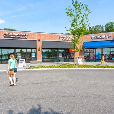 Massage Envy, European Wax Center and OshKosk B'gosh storefronts at Marketplace at Tech Center