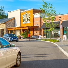 Whole Foods, Massage Envy and European Wax Center storefronts at Marketplace at Tech Center