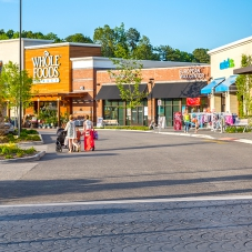 Whole Foods, Massage Envy, Carter's, DSW and European Wax Center storefronts at Marketplace at Tech Center