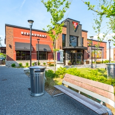 BJ's Brewhouse storefront and wooden bench at Marketplace at Tech Center