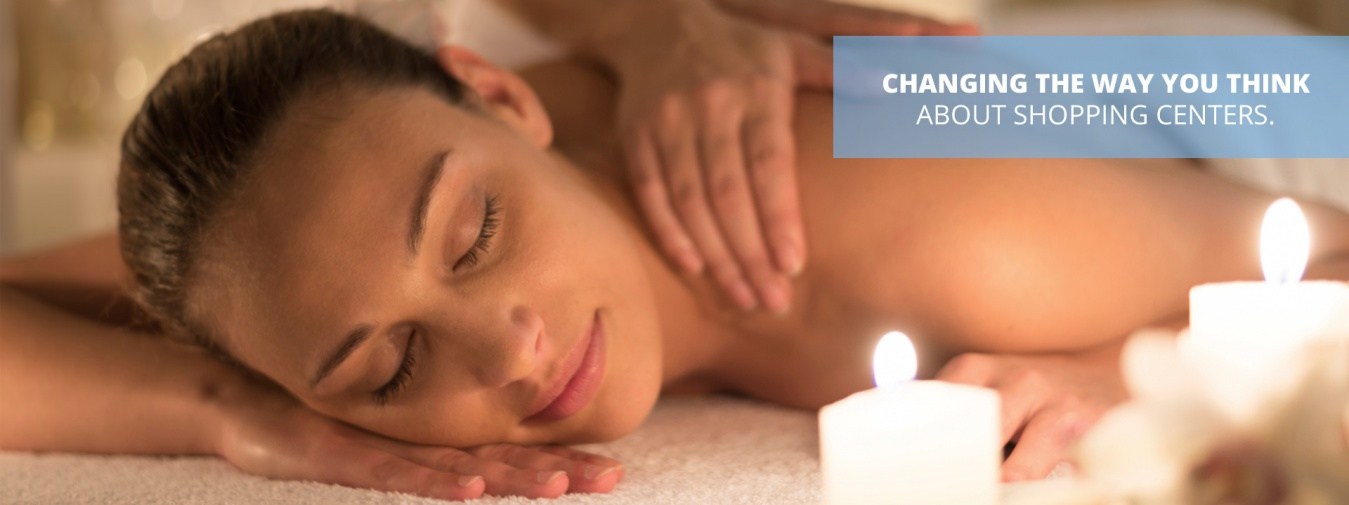 Woman receiving a relaxing, candlelit back massage